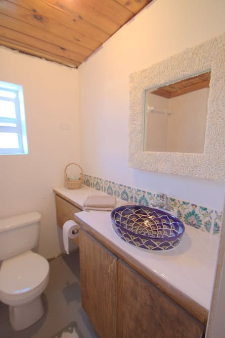 One of our bathrooms with hand painted tiles and basins
