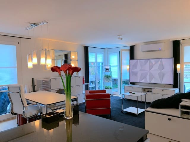 """Dining & Living Room with 75"""" TV and AirCondition"""