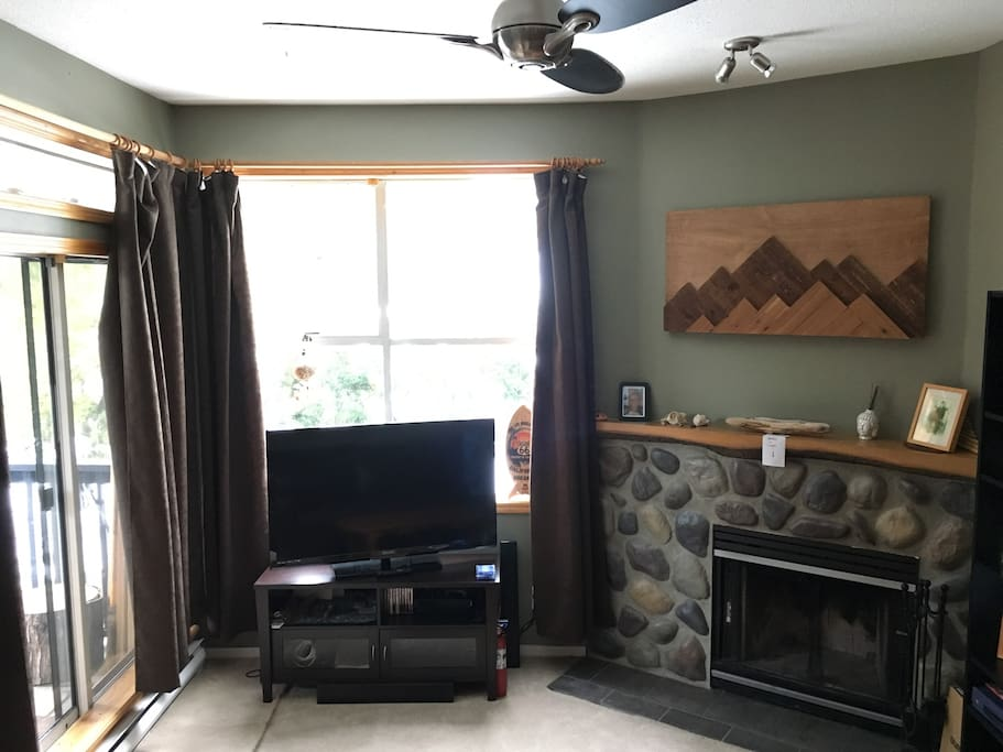 Smart TV and fireplace. Balcony door on the left