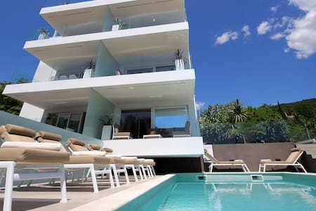 Designed apartment with the pool near the beach A2