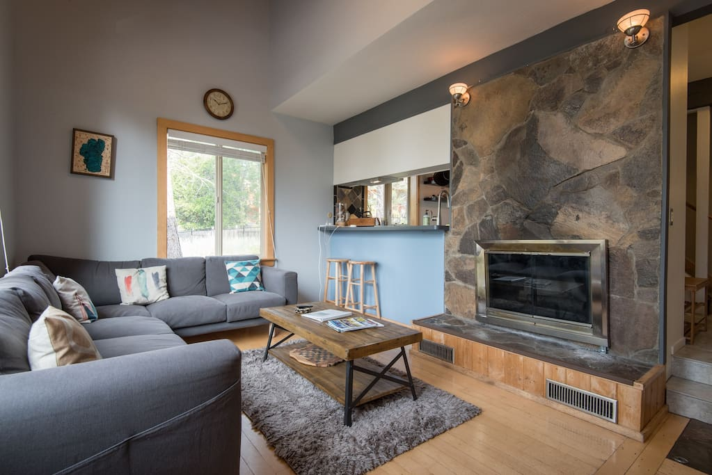 Cozy and inviting living room with vaulted ceilings and fully functional wood fireplace :)