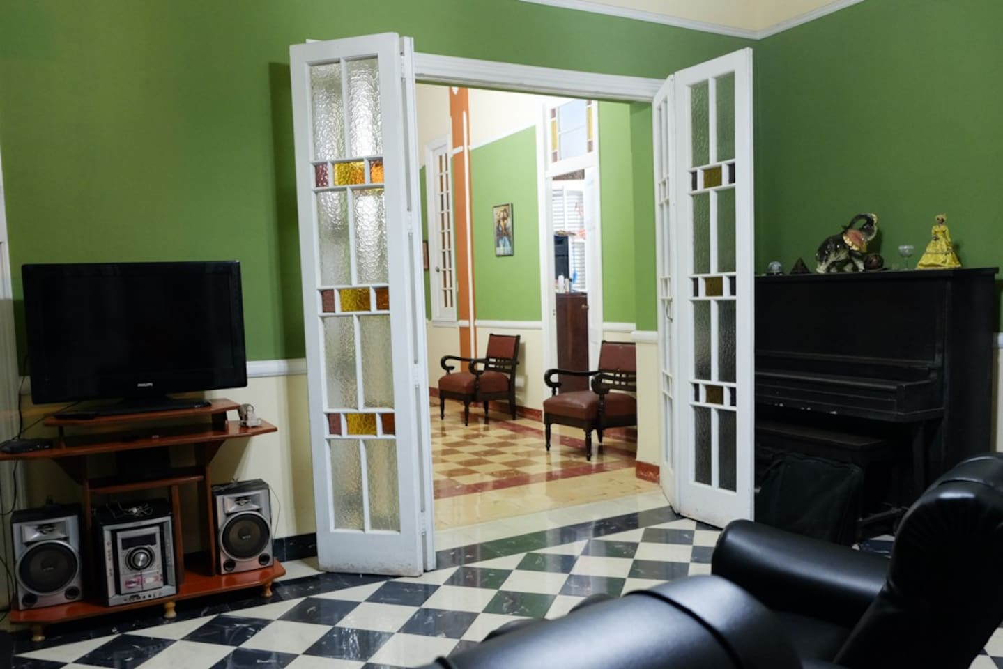 Relax in our chill living room, or step out to our private balcony overlooking the sights of Old Havana