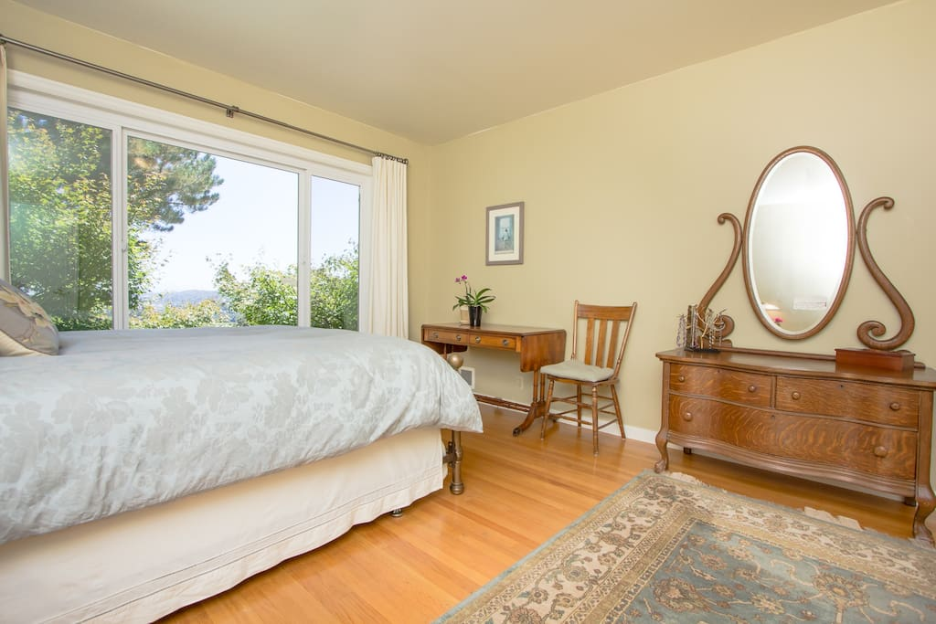 Master bedroom with view of the Bay and the Richmond Bridge