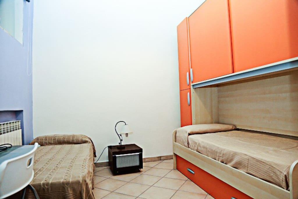 Camera letto con due letti singoli