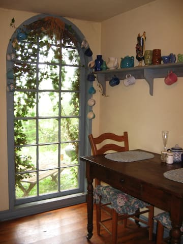 Enjoy a glass of wine and a view of the Ozark Mountain forest