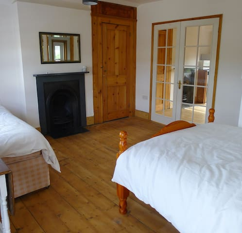 Sleeps 4 with double bed and two single stacked beds.