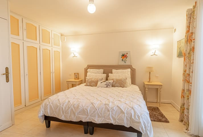Luminous bedroom with double bed