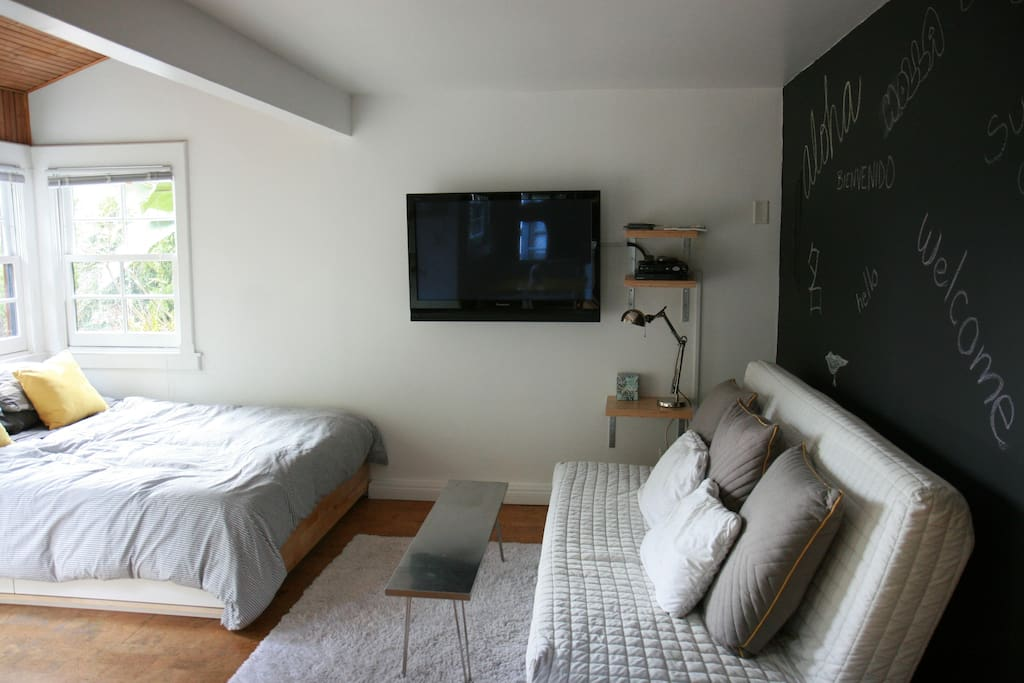Bright and uncluttered living space with fold down futon.