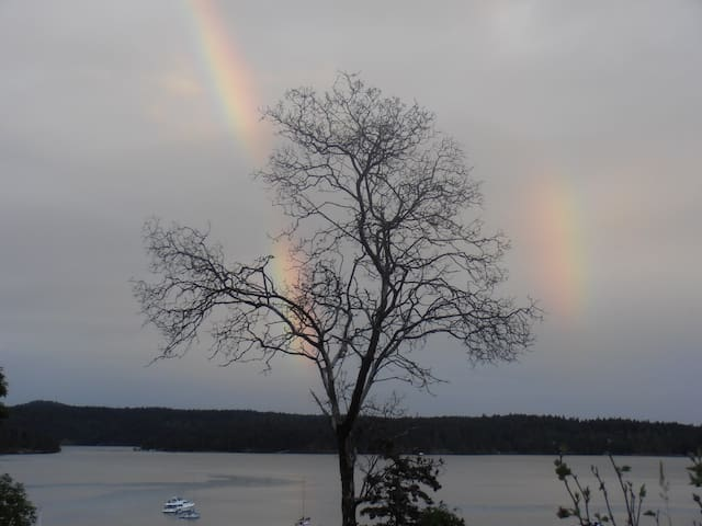 A beautiful and magical double rainbow over the harbor from your deck.