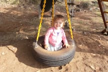 The tire swing at the playset is perfect for tiny ones!