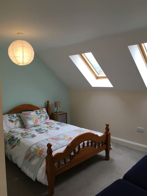 Top Floor suite with double bed and shower room.