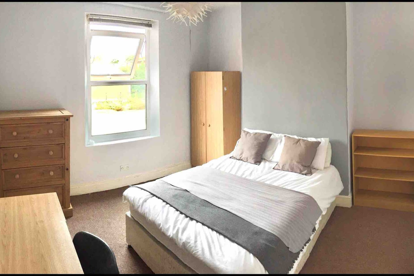 Your large bedroom. Double bed, all bedding, towel, wardrobe, chest of drawers, desk and chair.
