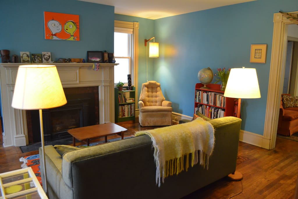 The Library (pictured with bed stored) features an arm chair and a gas fireplace.