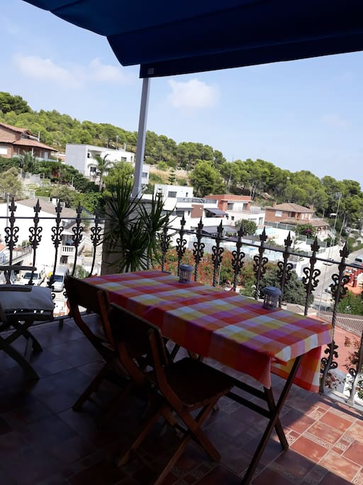 2017: Terrace with wooden furniture and new shading tent, view to garraf natural park