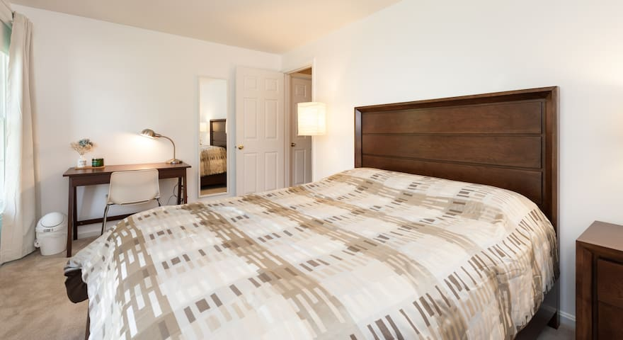 Upscale clean and aromatic sunny room with a luxury queen bed