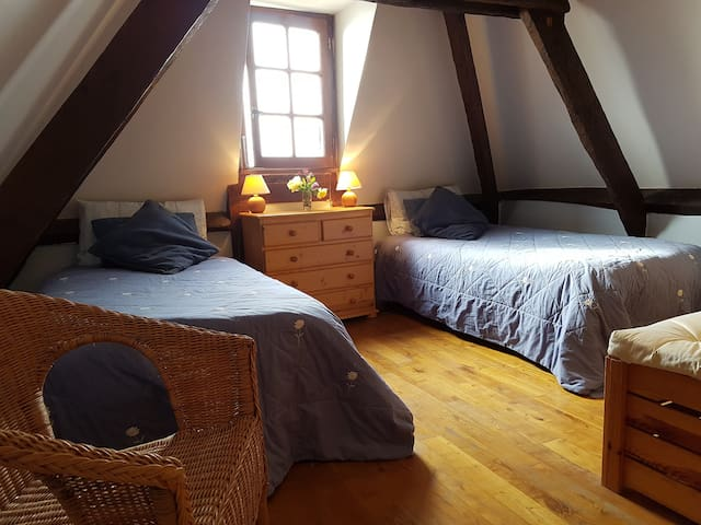 The upstairs bedroom with twin beds
