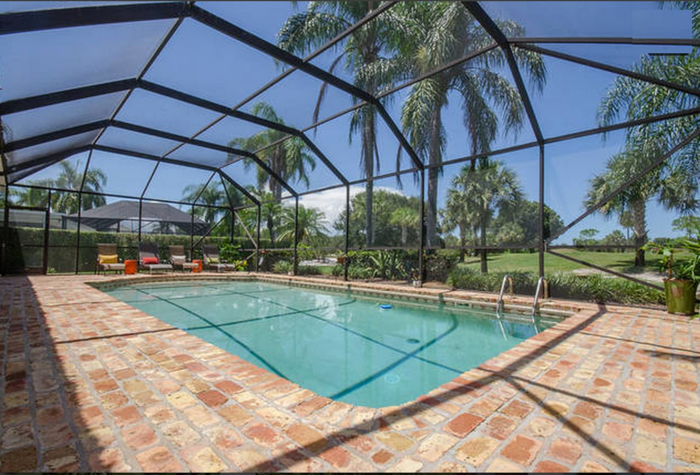Beautiful screened in pool overlooking golf course.