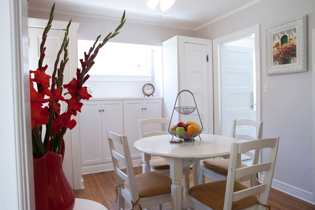 Charming dining room, bright and sunny.