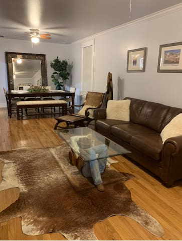 """Plenty of space for everyone to relax and watch tv on our 64"""" smart tv, eat meals at our extended table, play board games or just hang out with Clive!!"""