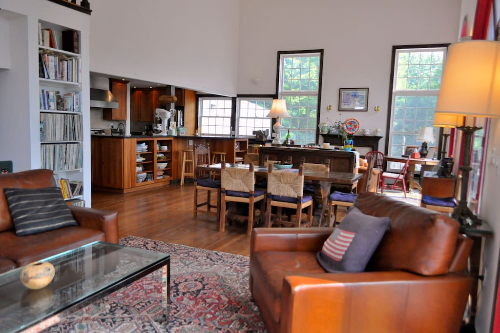 Great room with two seating areas, dining area, two fireplaces