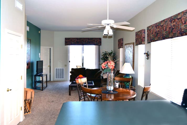 The dining and family areas from behind the kitchen island.