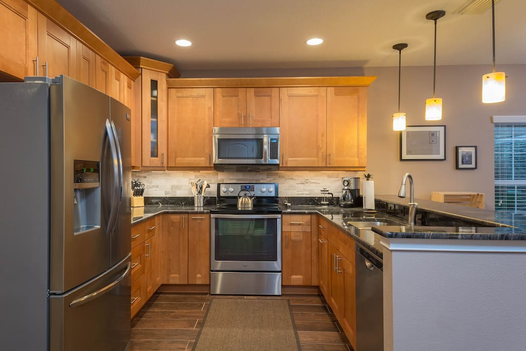 Beautiful kitchen with custom granite counters and stainless appliances.