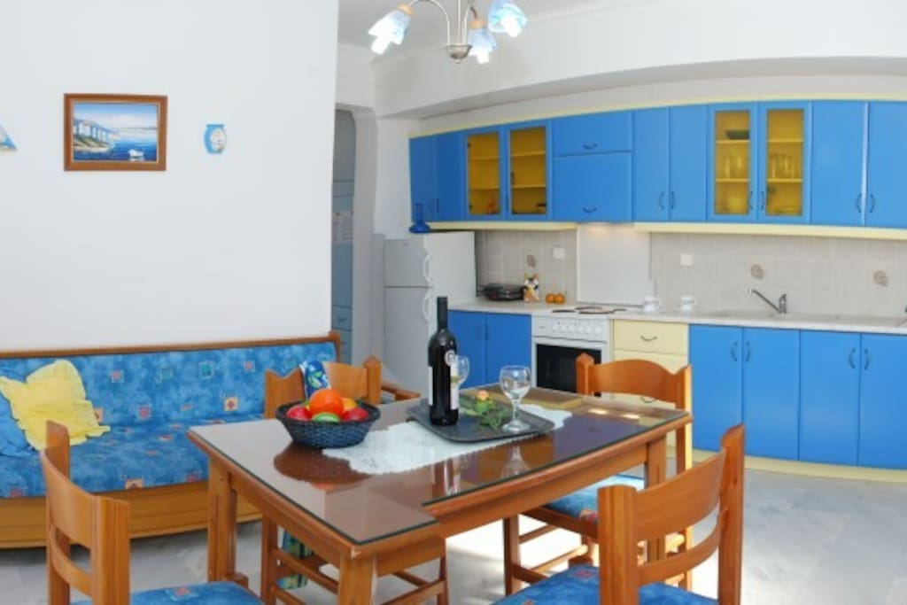 A fully equipped kitchen with full sized cooker, fridge freezer and kettle offering sea view from the window