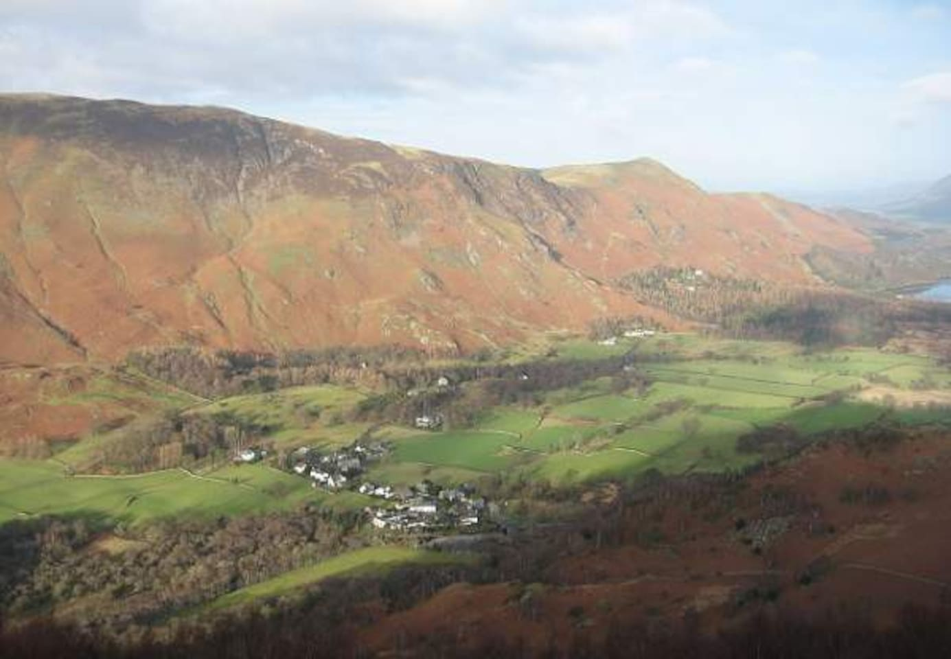 Arial view of Grange village and the fells.