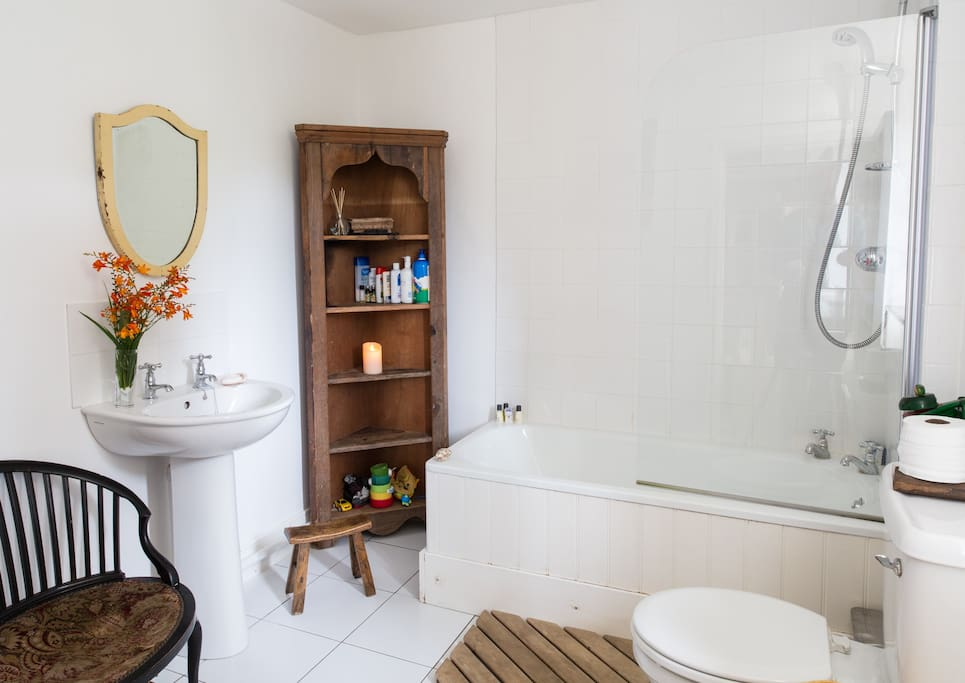 The bathroom for the Attic has a bath and shower (combined). Do be aware that it's quite a walk from the Attic Room.