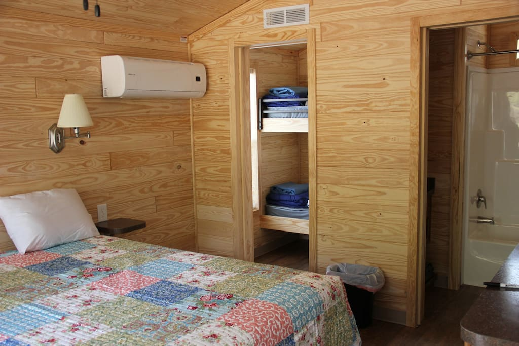 You can see a glimpse of the bathroom and bunk room but the main focus is the large queen sized bed.