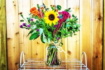 Farmhouse Flower Arrangement ($65) can be added to your stay. A bouquet of seasonal flowers waiting in your room when you arrive. Lovingly arranged into a whimsical, romantic mix with colors inspired by nature. Includes farm-style vase and accents.
