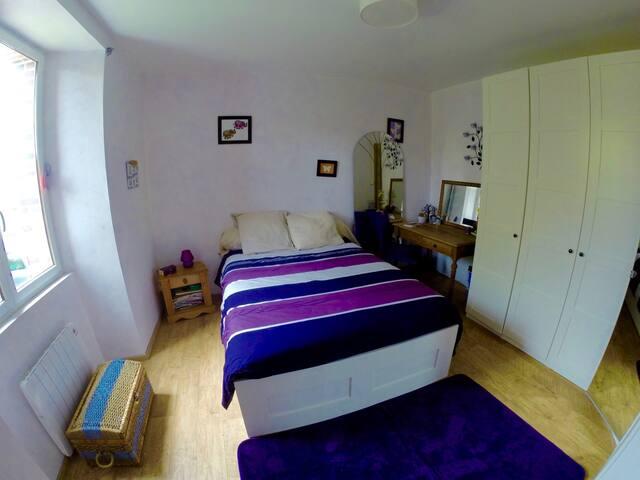 Chambre double 15m2 en rez-de-chaussée