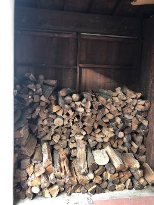 Dry stacked oak for the fireplace.