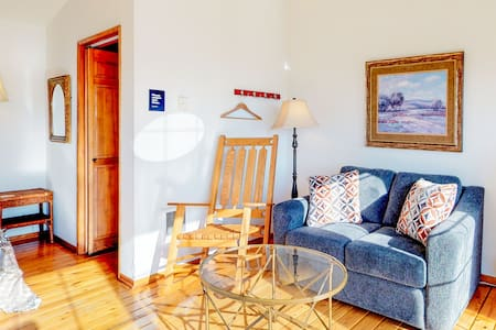 Enjoy ocean views from the shared deck of this lovely dog-friendly suite!