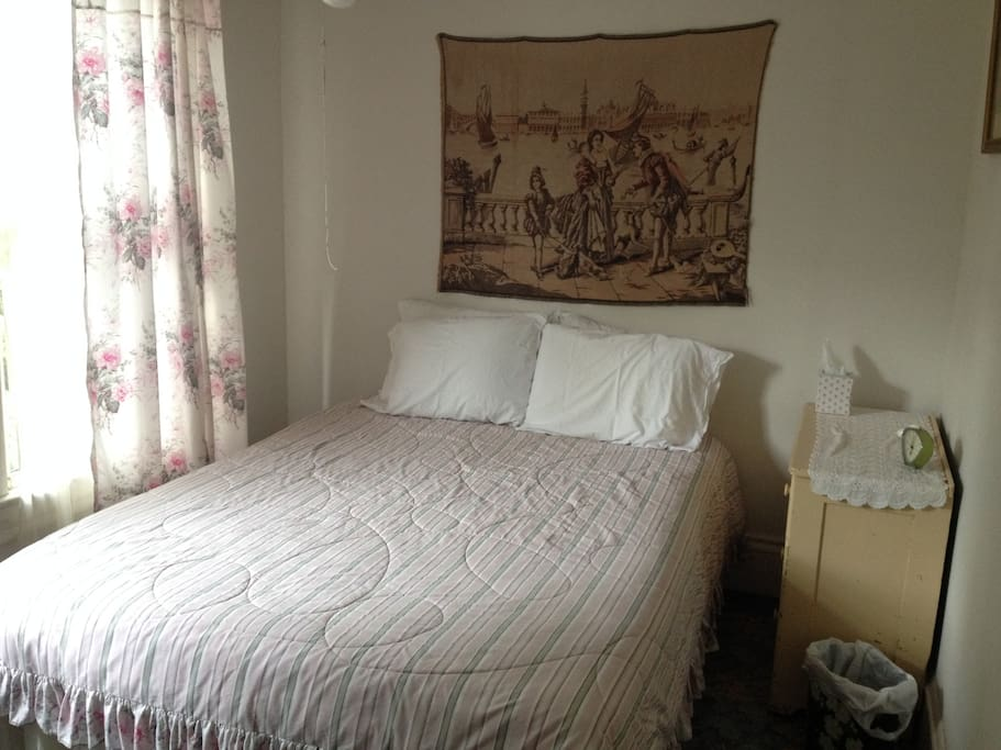 Blue Heron room offers a queen bed and a view of Blue Mountain