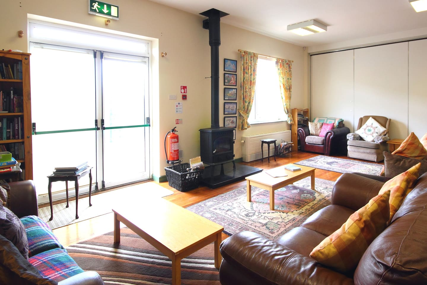 Our spacious and comfortable lounge with TV, wood burning stove and self-catering kitchen