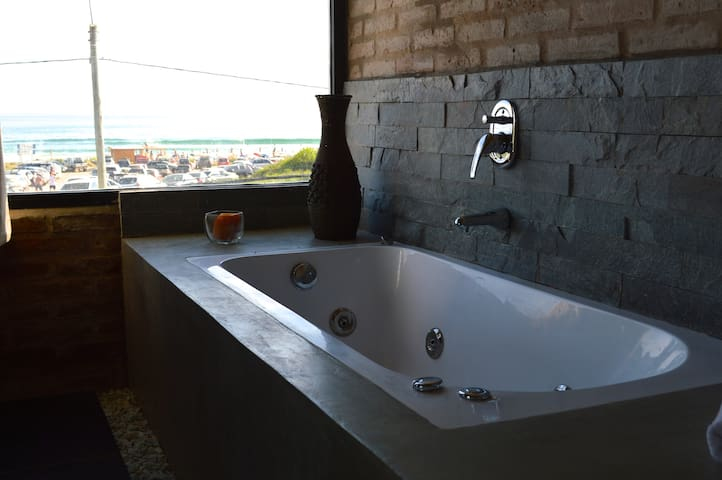 Relax in the tub with a nice view of Anaconda beach.