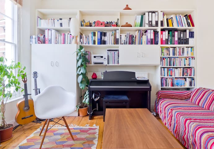 Living room - the table is multi-purpose, converting from a coffee to a large dining table.