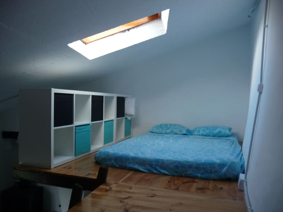 double attic room with velux window and large corridor with library....
