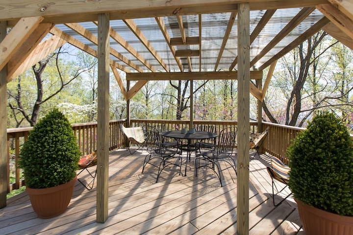 A covered deck provides an outdoor gathering area. You can turn on Japanese lantern lights (not pictured) or fan to add to your comfort. A gas grill is conveniently located on the deck.
