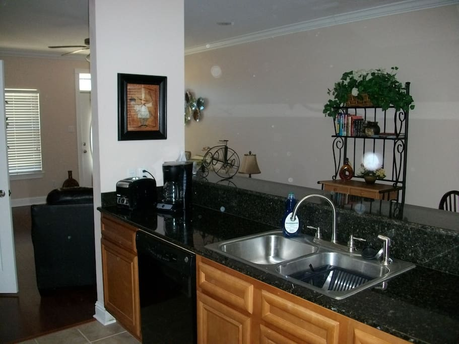 Kitchen with granite countertops and all the necessary appliances