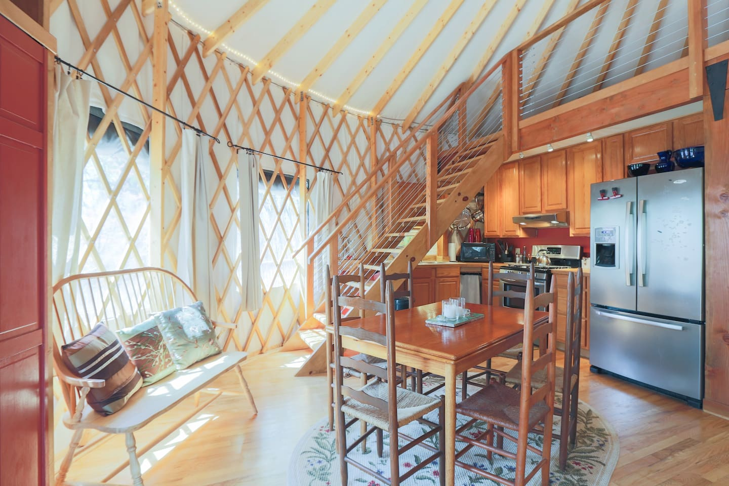 The stairs lead to a loft containing a queen size bed, two twin beds, musical instruments and the sky dome.