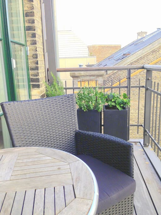 The darling of this apartment - the great sunny balcony! Table and chairs for two persons. Afternoon and evening sun!