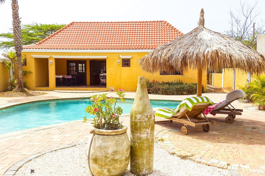 Spacious family home with a big backyard. A villa with the vacation  atmosphere around you.