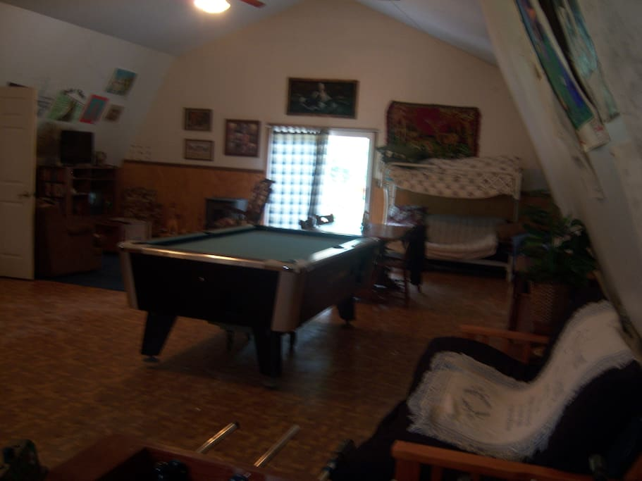 Inside facing back door Pool table futons