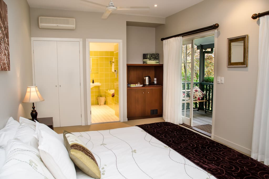 King bed with spa bath and garden views