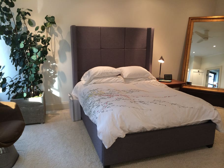 Large master bedroom with plenty of space for luggage