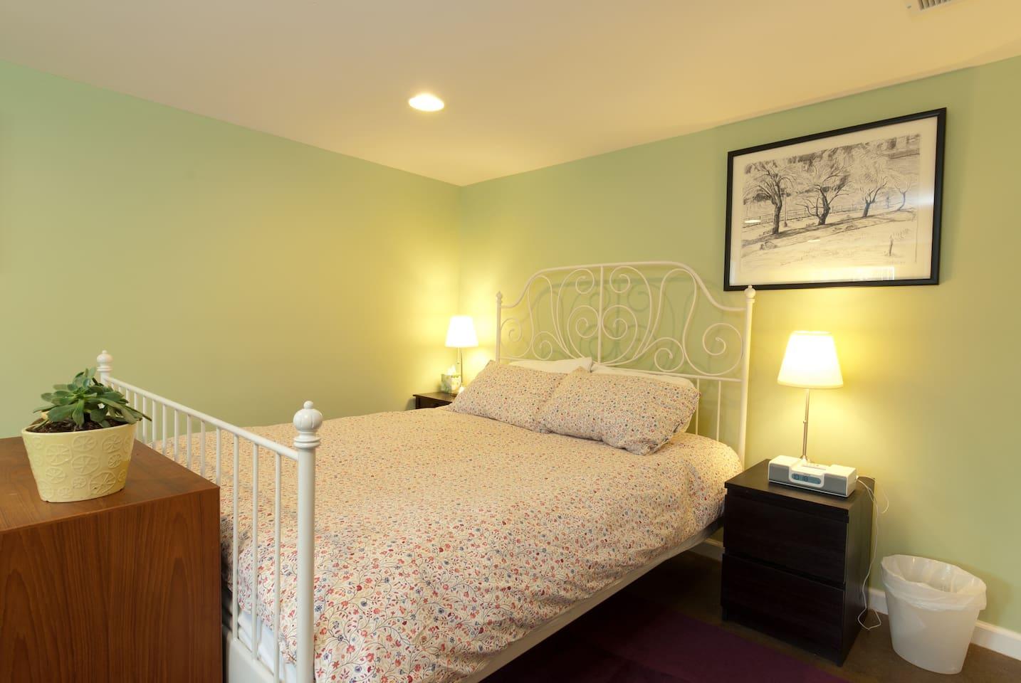 cozy, queen bed in spacious room