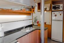 A fully equipped kitchen... fridge, freezer, microwave ...