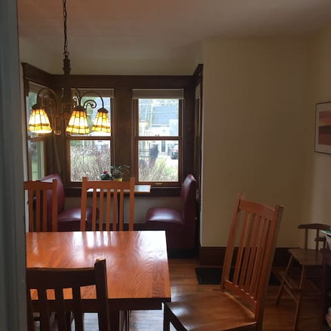 Large dining room with breakfast nook.